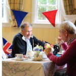 Villagers enjoying tea and raising money for the Red Cross